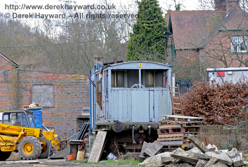 The nearby contractor's yard seems to have acquired a brake van.  09.03.2011  6126