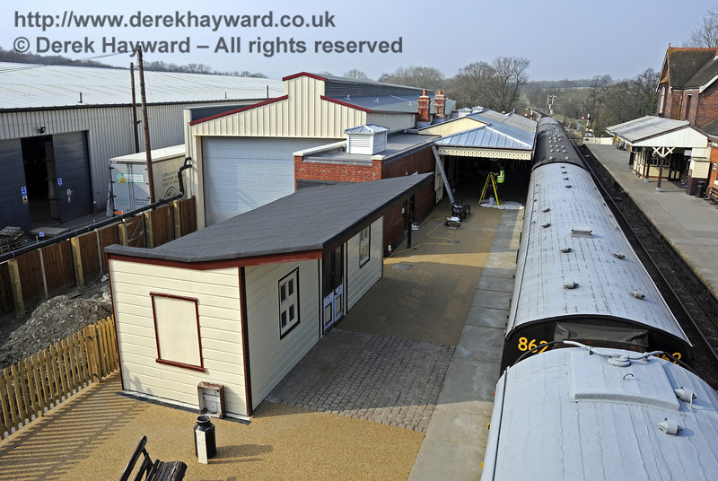 Looking north along Platform 2 from the footbridge, with the former Isfield building nearest the camera.  25.03.2011  6571