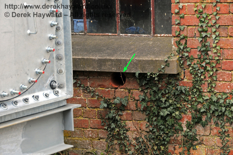 A hole (arrowed) has been drilled to allow pipes from the new water tank to enter the water tower.  09.03.2011  6131