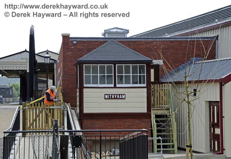 The Withyham signal box has been refurbished externally although internal fitting out remains outstanding.  Meanwhile the adjacent fence was being painted.  28.04.2011  0943