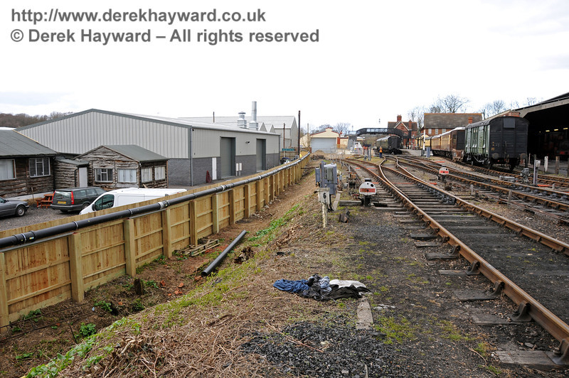 Looking north from the water tower towards the Carriage Shed.  On the left is the new fence, with the pipe feeding rain water from the shed to the new tank fixed to the top.  09.03.2011  6138
