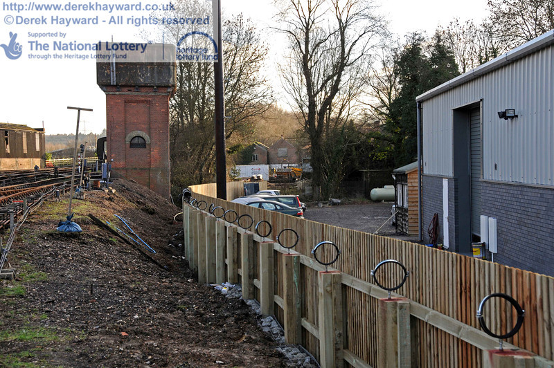 The newly erected fence, and hoops to support the rainwater harvesting pipes, looking south. 18.01.2011  5540