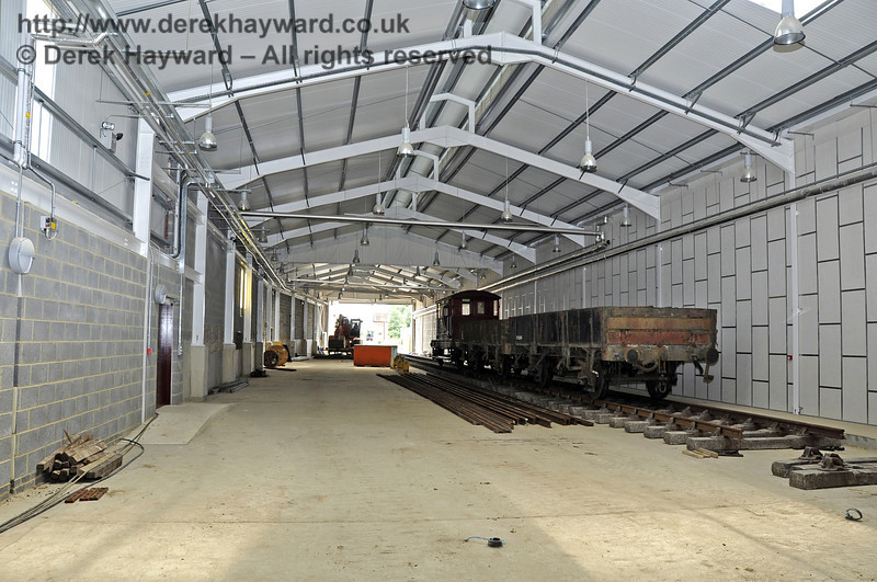 Inside the Carriage Shed with stock standing on what will be A road.  This view looks south.  03.07.2011  2082