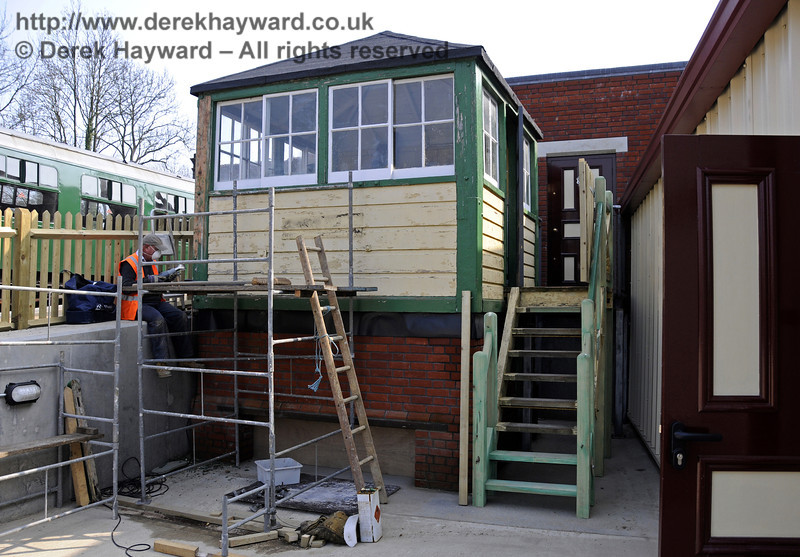Looking south at the Withyham signal box with installation of the steps and refurbishment in progress.  25.03.2011  6530
