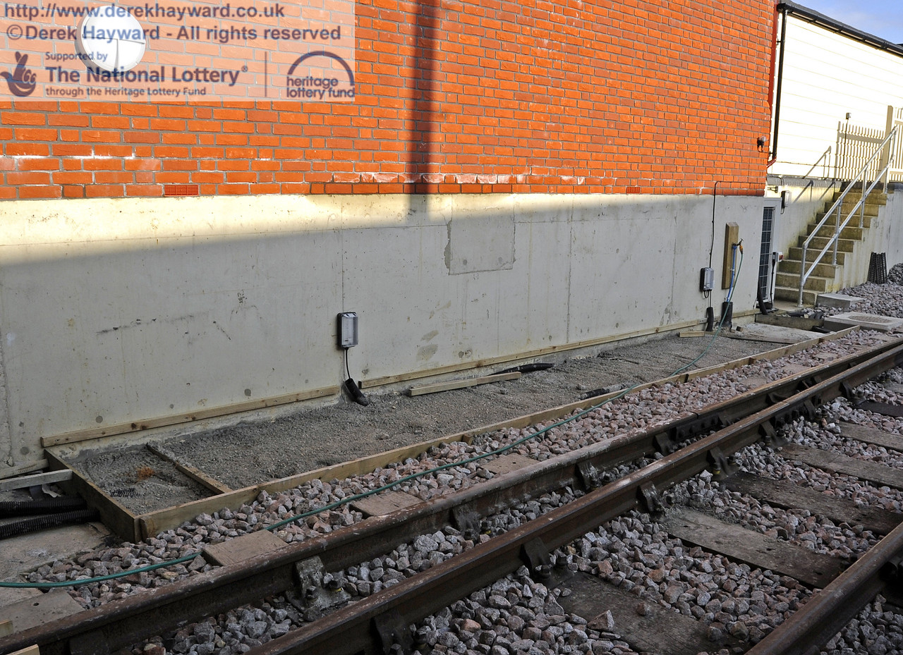 The path outside the shed is also not yet complete.  Water and electrical trunking can be seen.  10.03.2012  3765