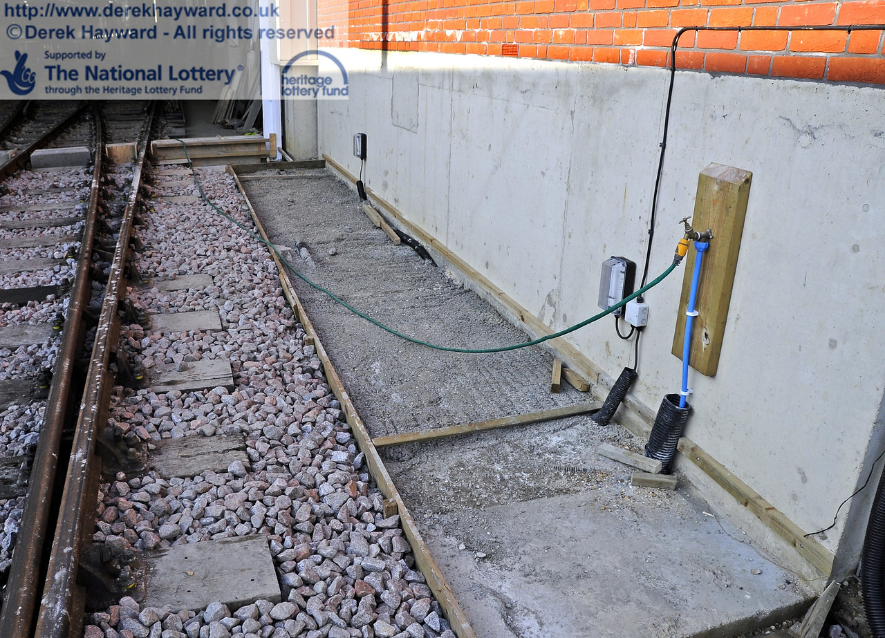 The path outside the shed is also not yet complete.  Water and electrical trunking can be seen.  10.03.2012  3766