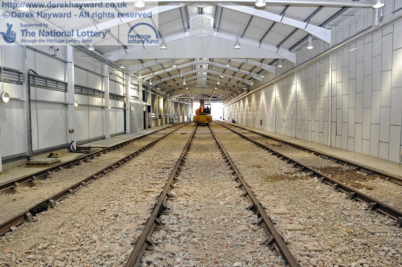 Looking south in the Sheffield Park Carriage Shed with the fill material around the tracks now level. 10.03.2012  3758