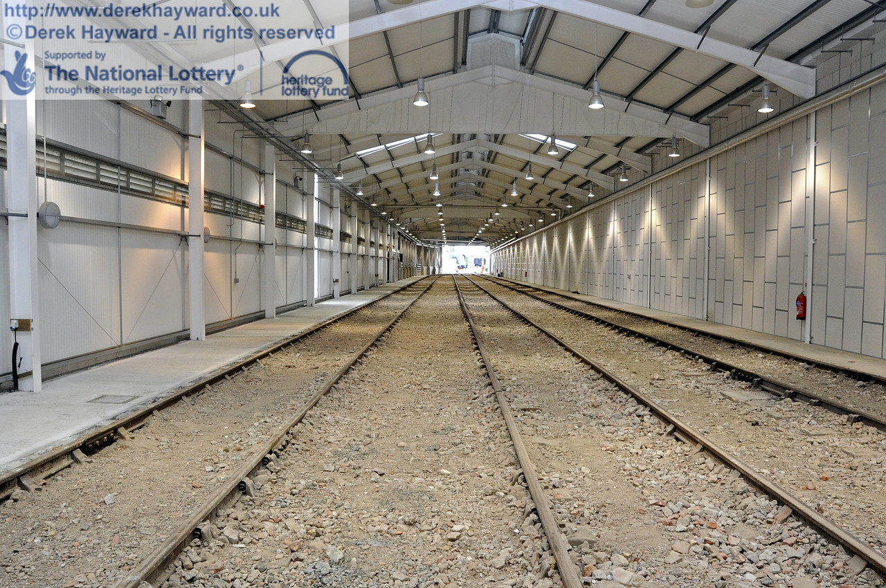 Looking south along the length of the Sheffield Park Carriage Shed, with the fill material level and the side paths complete.  20.03.2012  3885