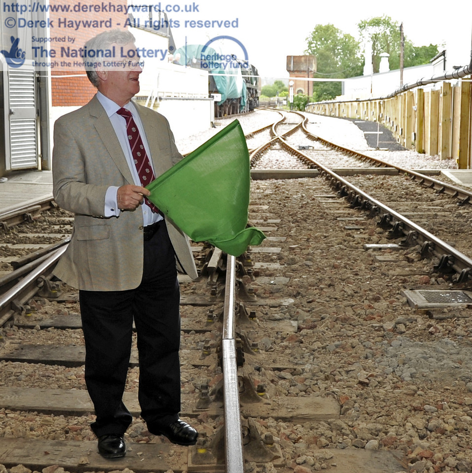 Nicholas Pryor looks across to the shunter, giving the signal for the official train to leave the shed.  16.06.2012  5067