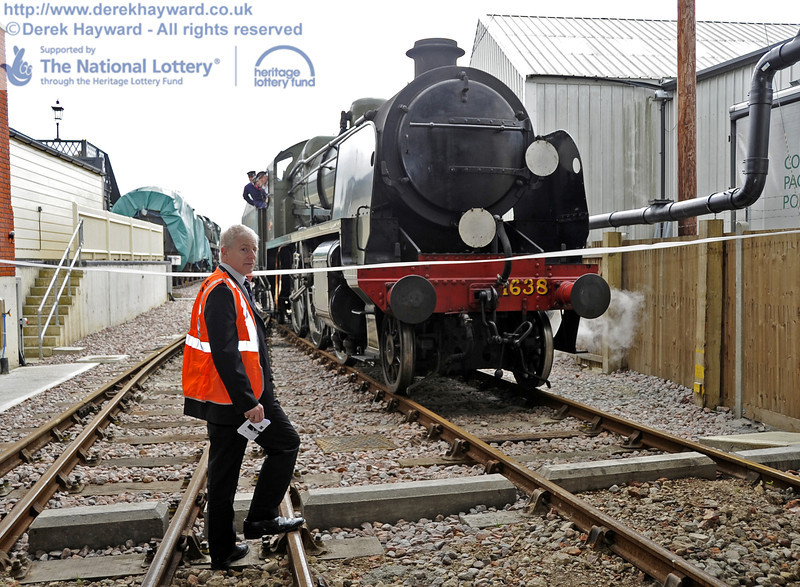 BRPS President Roy Watts holds the tape as 1638 draws up for the official opening of the SP Carriage Shed.  16.06.2012  5040.  Please note that owing to restricted sight lines it is obligatory for Roy to wear hig-viz clothing in this position.