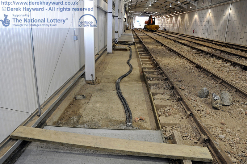 Some sections of the concrete path on the eastern side have yet to be completed.  The electrical trunking can be seen.  10.03.2012  3756