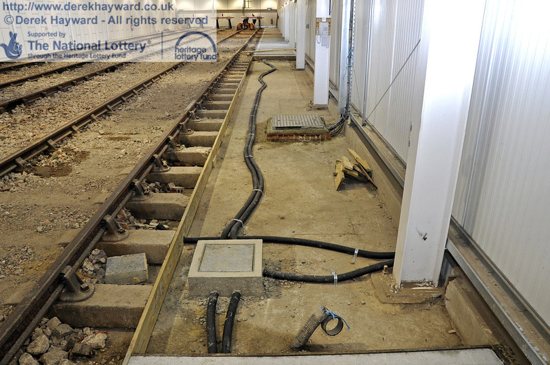 Some sections of the concrete path on the eastern side have yet to be completed.  The electrical trunking can be seen.  10.03.2012  3759