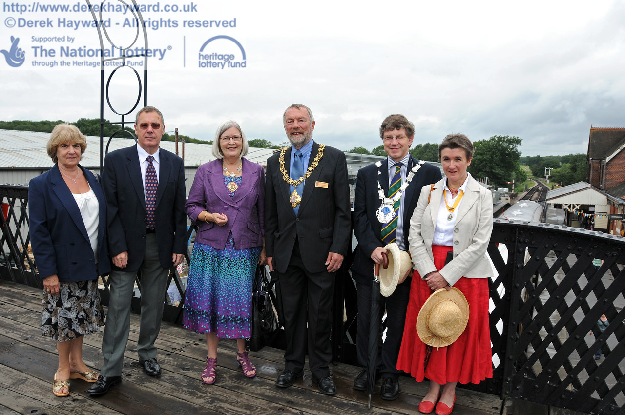 On 22.08.2010 the progress of the work was reviewed by guests of the railway.  Seen on the footbridge at Sheffield Park are (left to right) Janet Rossiter and David Rossiter (Stagecoach Buses), Anne Turner (Mayoress of Lewes), Dr Michael Turner (Mayor of Lewes), Councillor Steve Barnett (Mayor of East Grinstead) and Pauline Barnett (Mayoress of East Grinstead).  4246