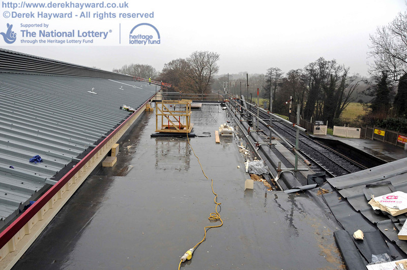 Looking north along the virtually complete Museum roof in somewhat inclement conditions. This area is now watertight (but the photographer is not....) 15.12.2010  5475