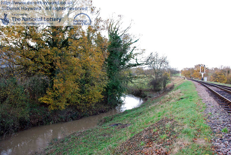 Looking north along the River Ouse from the northern end of the railway bridge.  This area will be untouched by the project and remain a natural habitat.  The river is not always muddy.  It was in flood following heavy rain. 15.11.2009