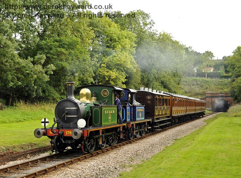 178 and 323 Bluebell steam north through the site of the former West Hoathly Station.  24.09.2011  2972
