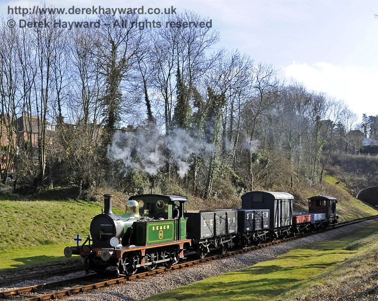 178 passes through the site of the former West Hoathly Station with a goods train.  10.03.2012  3735