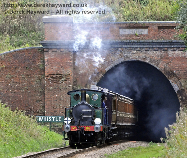 178 and 323 Bluebell emerge from West Hoathly Tunnel.  24.09.2011  7584