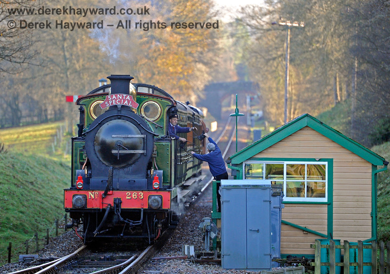 263 surrenders the single line token at Kingscote whilst hauling a Santa Special. 13.12.2014 10198
