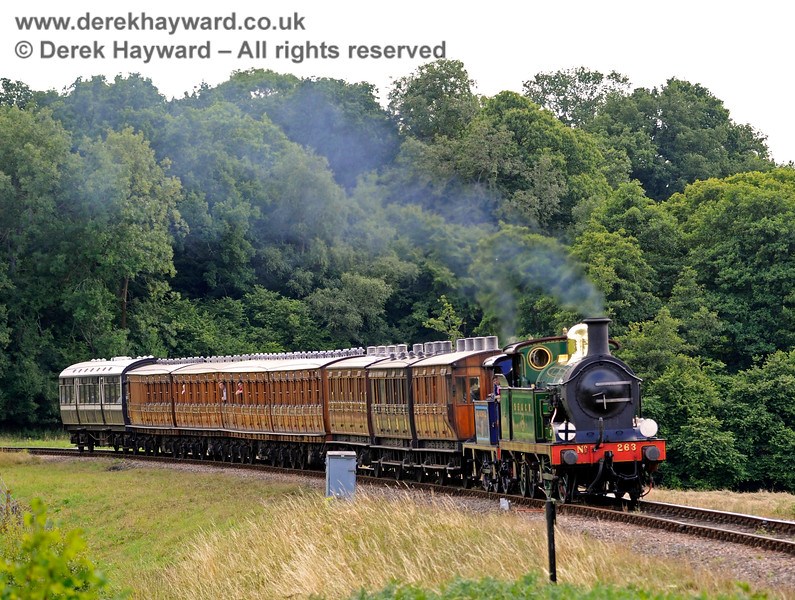 263 and 323 approach Horsted Keynes with the Victorian coaches.  10.08.2013  7759