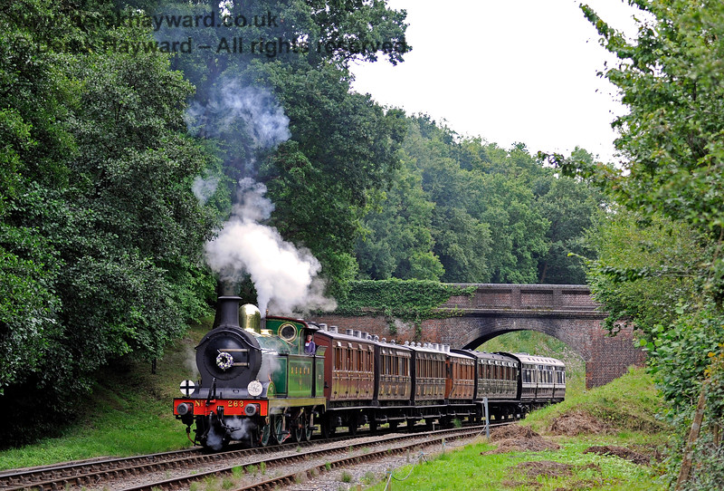263 passes under Leamland Bridge with a selection of vintage coaches. It carries a wreath in memory of the late Simon Brown, a much respected volunteer. 13.08.2016 13759