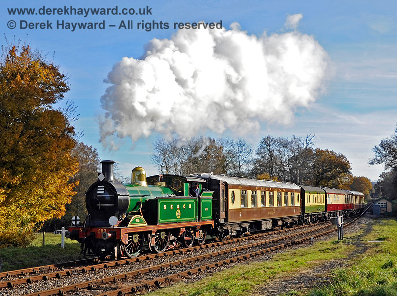 263 arrives at Kingscote with the Golden Arrow. The second van (for the Guard) was originally in Pullman livery but an unfortunate and unexpected chemical reaction turned the paint green.  It was later repainted again.  18.11.2012 5797