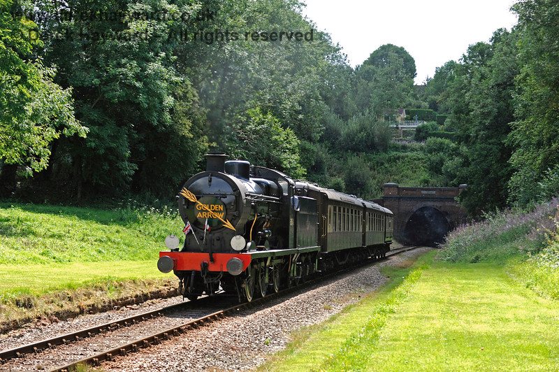 30541 steams through the site of the former West Hoathly station. 06.08.2017 15867