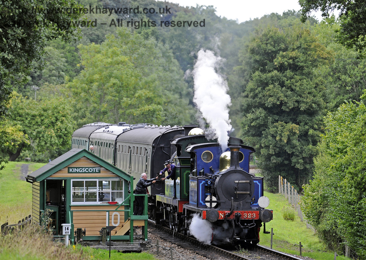 323 Bluebell and 263 collect the single line token as they pass Kingscote signal box.  01.09.2013  8042