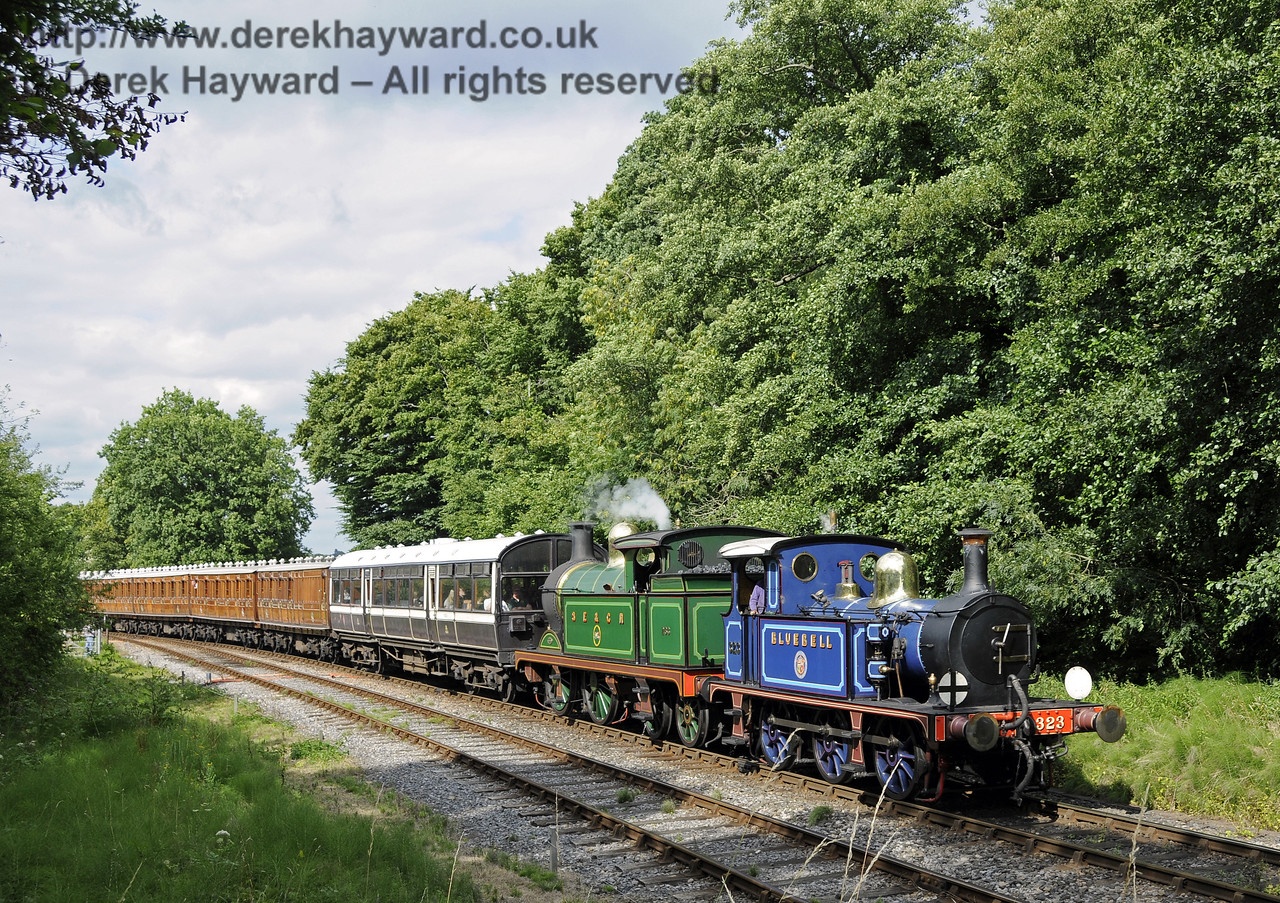323 Bluebell and 263 approach Leamland Bridge with a service train.  10.08.2013  9643