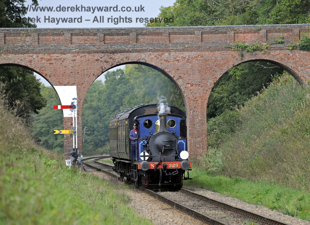 323 hauls an Autumn Tints train south through Three Arch Bridge.  02.10.2014  10055