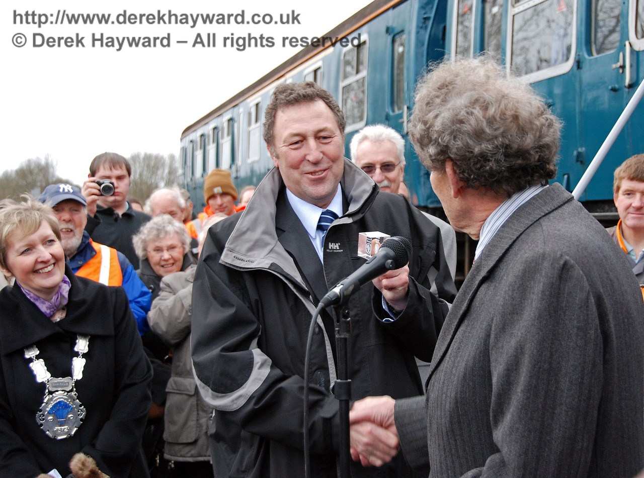 Mac Macintosh (former Engineering Director SWT) receives a ceremonial pound coin from Gordon Pettitt in payment for the train. East Grinstead 17.01.2009  94