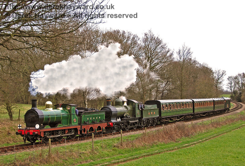 65 and 9017 Earl of Berkeley steam round the curve from Sloop Bridge.  24.02.2007