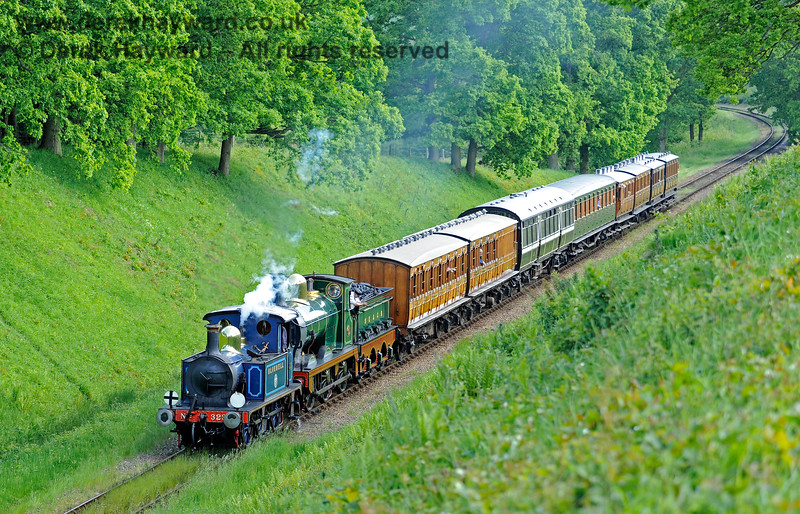 323 Bluebell and 65 haul a nice selection of vintage coaches north through the cutting leading to Three Arch Bridge.  20.05.2018 16583