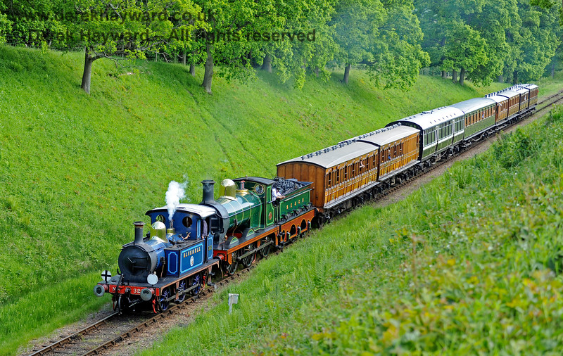 323 Bluebell and 65 haul a nice selection of vintage coaches north through the cutting leading to Three Arch Bridge.  20.05.2018 16586