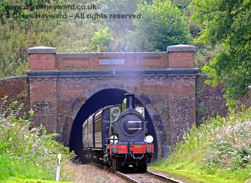 65 emerges from West Hoathly Tunnel with a service train. 27.08.2017 15987