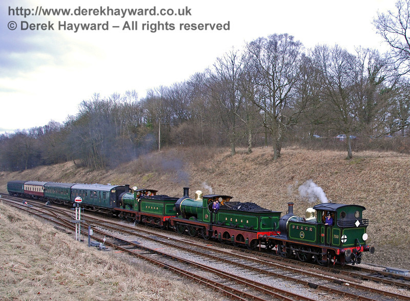 753 (visiting), 592 and 65 steam south into Horsted Keynes.  22.02.2009  0073