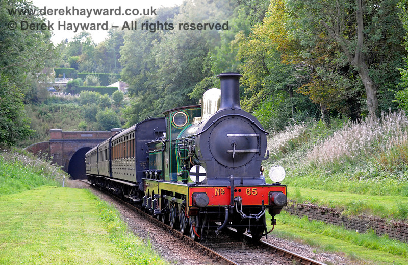 65 hauls a service train north through the site of the former West Hoathly station. 27.08.2017 15994