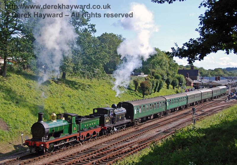 65 and 32473 steam north from Horsted Keynes with a service train.  12.08.2007  0150