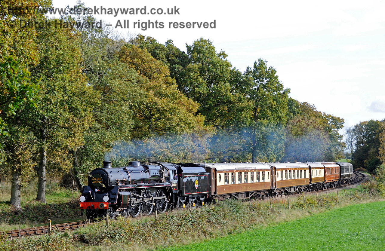 73082 Camelot operated it's first scheduled passenger service today, hauling the Golden Arrow, which also included coaches that were part of a private charter.  The train is seen north of Sloop Bridge.  25.10.2015  12306