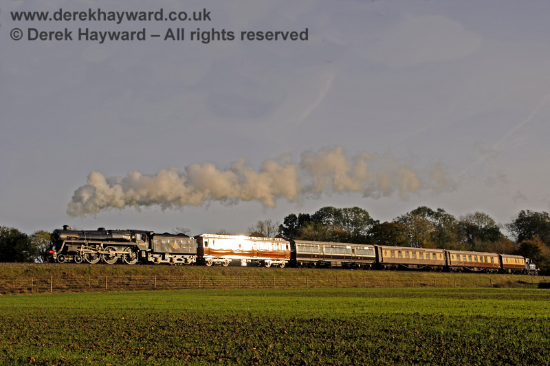 The GN Saloon glints in the sun as 73082 Camelot hauls a special train towards New Road Bridge. 25.10.2015 13919
