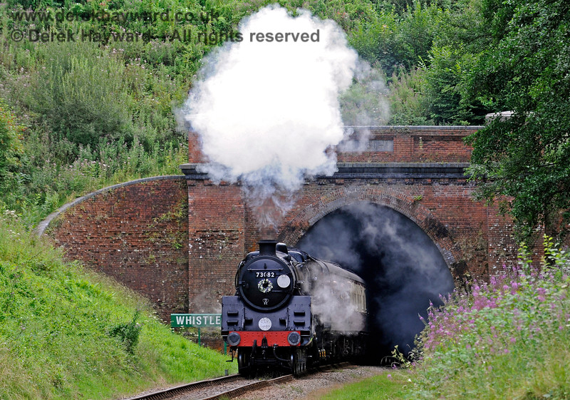73082 emerges from West Hoathly tunnel carrying a wreath in memory of Simon Brown, a much respected volunteer. 13.08.2016 13763
