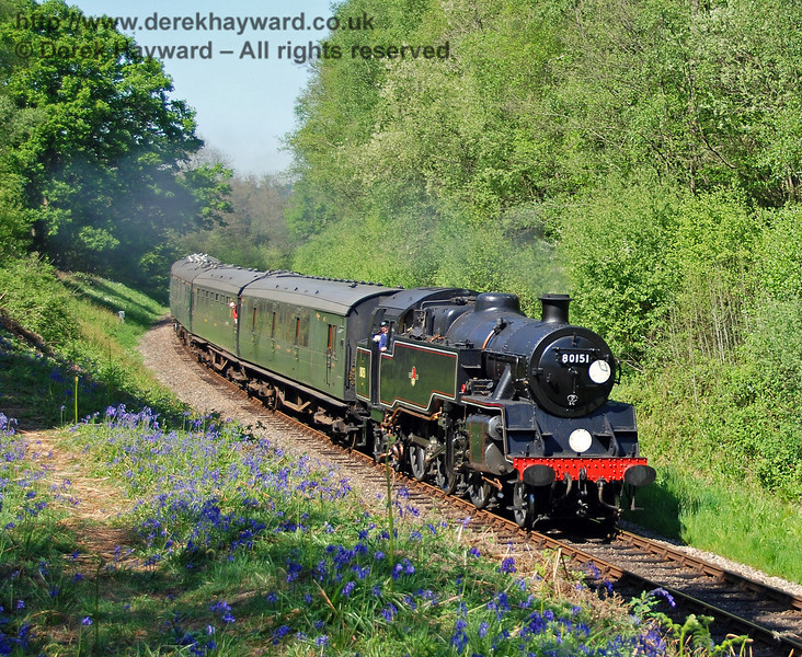 The bluebells are in bloom as 80151 drifts through Lindfield Wood with a service train. 01.05.2007