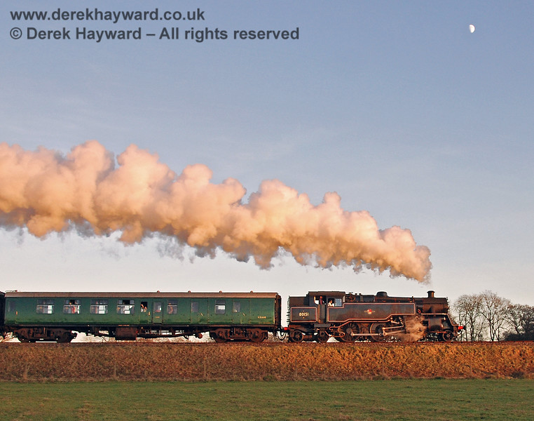 The setting sun catches the steam and the Moon is in the sky above as 80151 leaves Horsted Keynes. 07.12.2008