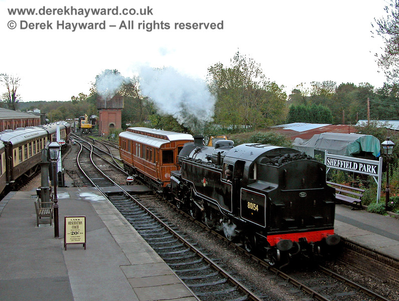 The motive power for the Directors Saloon may be over-generous as 80151 (running as 80154) hauls the coach into the platform at Sheffield Park. 27.10.2006