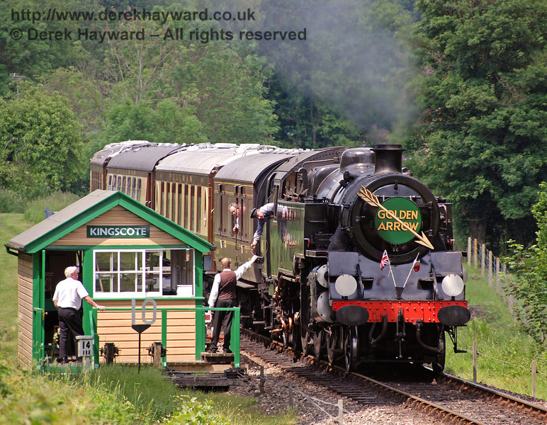 The crew of 80151 collect the single line token as they leave Kingscote with the Golden Arrow. 03.06.2007