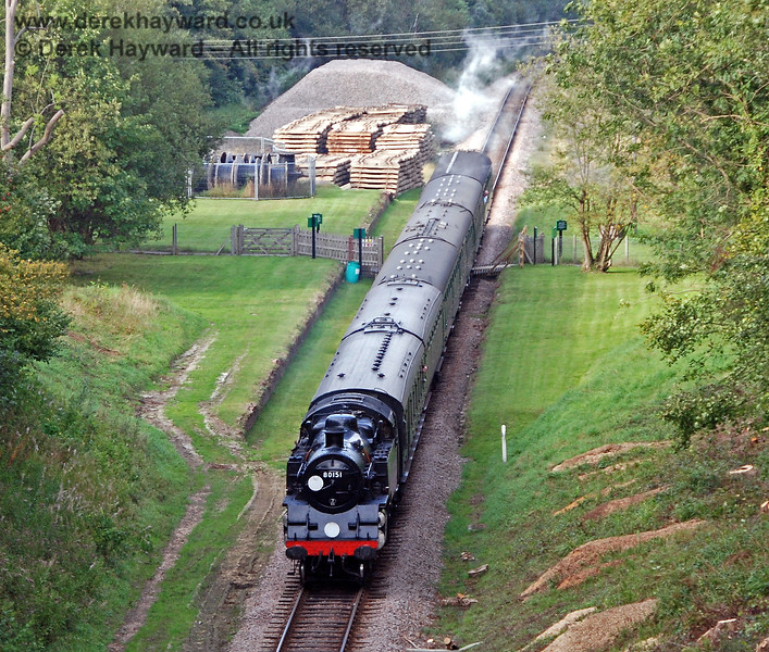 Who remembers 2007, when the goods yard at West Hoathly was packed with sleepers and ballast for East Grinstead.  80151 passes over West Hoathly Foot Crossing as it heads for the tunnel. 23.09.2007