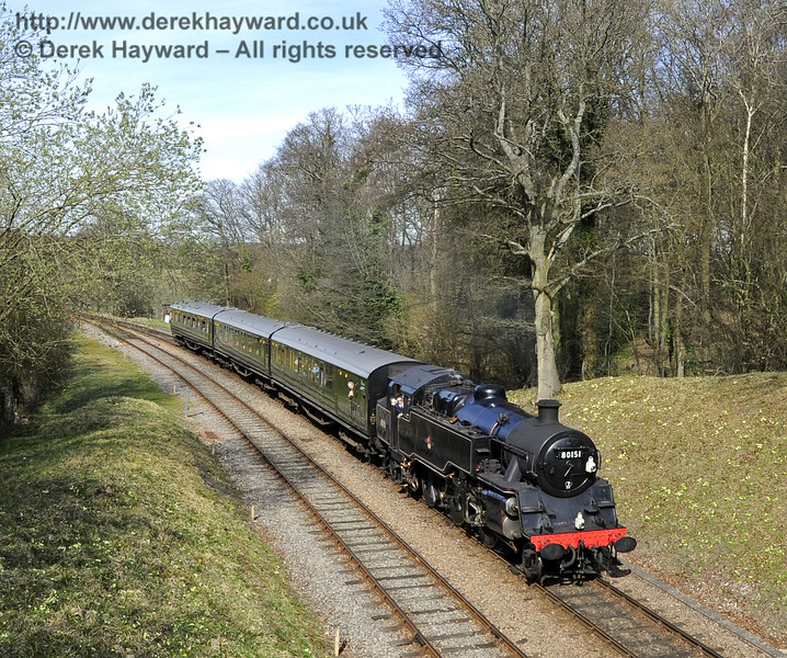 With the primroses in bloom on the embankment, 80151 approaches Leamland Bridge.  25.03.2012  4097