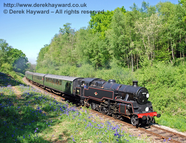 The bluebells are in bloom as 80151 steams south through Lindfield Wood with a service train. 01.05.2007