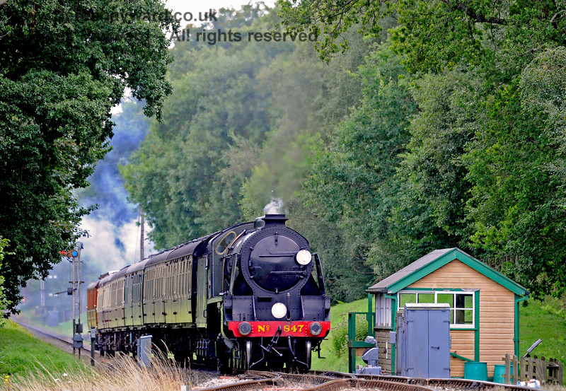 847 passes the disused southern signal box at Kingscote. 19.08.2017 15918