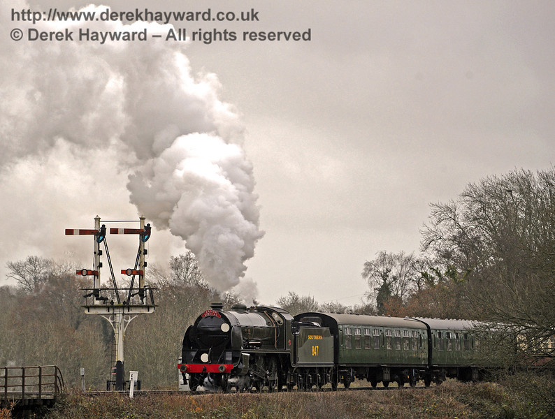 In somewhat overcast conditions, 847 leaves Sheffield Park on it's first day of public service.  14.12.2013  8497